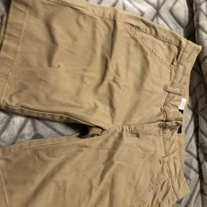 A couple pairs of khaki shorts.